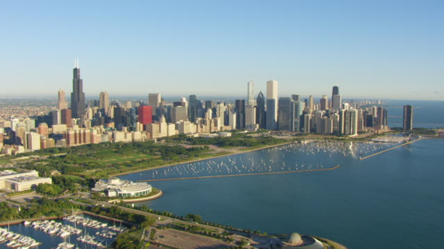 WS AERIAL POV View of Grant Park with city skyline and Lake Michigan / Chicago, Cook County, Illinois, United States
