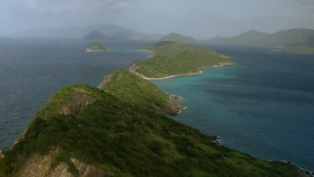 ws tu aerial pov view of grass cay island, mingo cay and lovango cay in background / grass cay, us virgin islands, united states - cay insel stock-videos und b-roll-filmmaterial