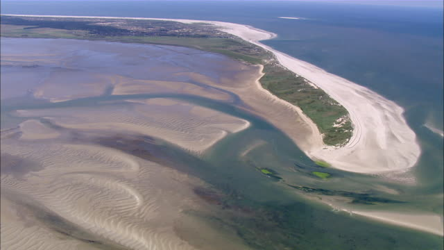 ws aerial view of grassland city near sea / syltfoehr, schleswig-holstein, germany - sylt stock videos & royalty-free footage