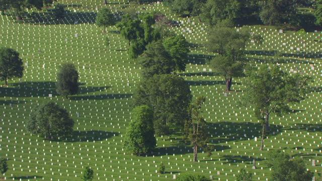 ws aerial pov view of gravestones at arlington national cemetery / arlington county, virginia, united states - arlington virginia video stock e b–roll