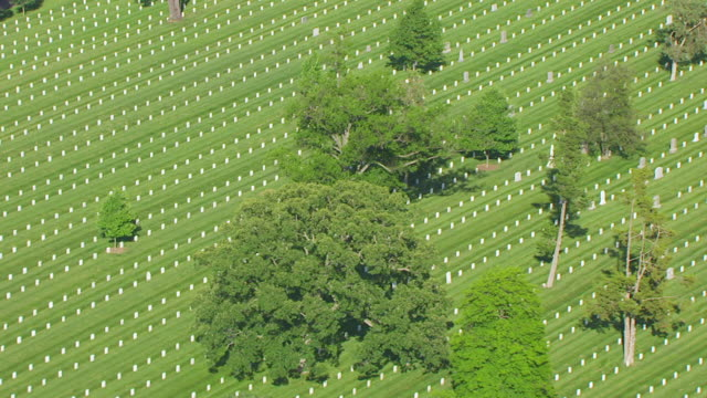 WS AERIAL POV View of gravestones at Arlington National Cemetery / Arlington County, Virginia, United States