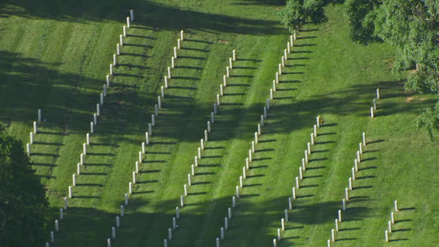 ws aerial pov view of gravestones at arlington national cemetery / arlington county, virginia, united states - arlington virginia video stock e b–roll