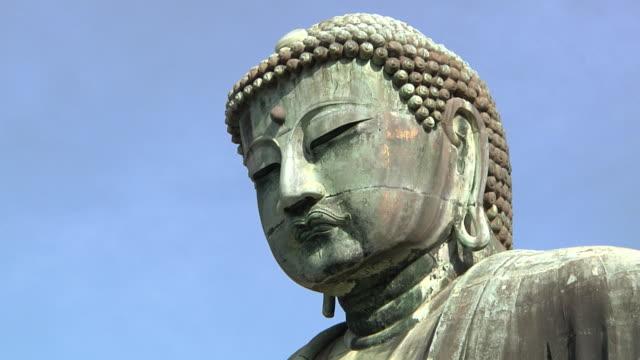 cu view of great buddha / kamakura, kanagawa, japan - japan stock videos & royalty-free footage