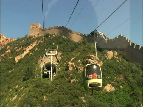 view of great wall of china from rear of cable car, point of view, pov, badaling, china - badaling stock videos and b-roll footage