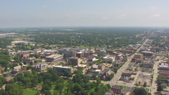 ws aerial pov view of greater campus and university buildings with city / champaign, illinois, united states - illinois stock videos & royalty-free footage