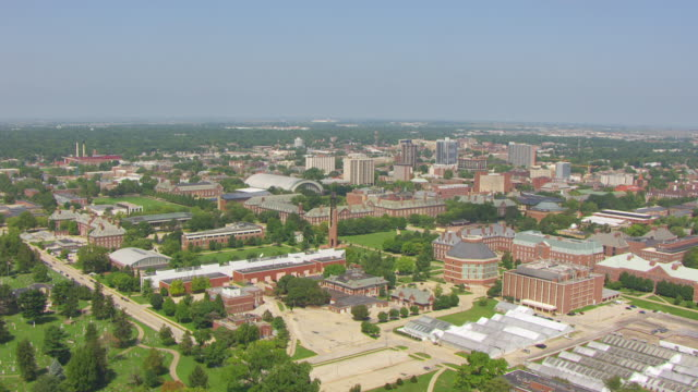 ws aerial pov view of greater campus and university buildings with mcfarland memorial bell tower / champaign, illinois, united states - illinois stock videos & royalty-free footage