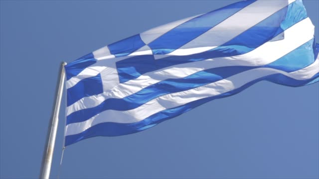 view of greek flag in the breeze, athens, greece, europe - greek flag stock videos & royalty-free footage