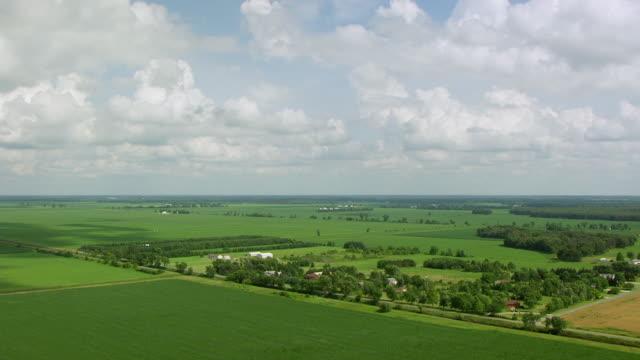 WS AERIAL POV View of green farmland / Porter County, Indiana, United States