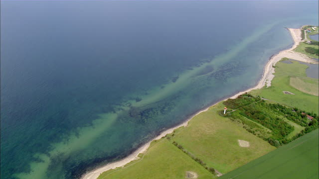 aerial ws view of green field at near ocean / holstein switzerland, schleswig-holstein, germany - schleswig holstein stock videos & royalty-free footage