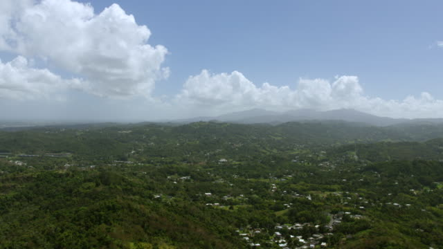 WS AERIAL POV View of Green foothills and mountains in background / Trujillo Alto, Puerto Rico, United States