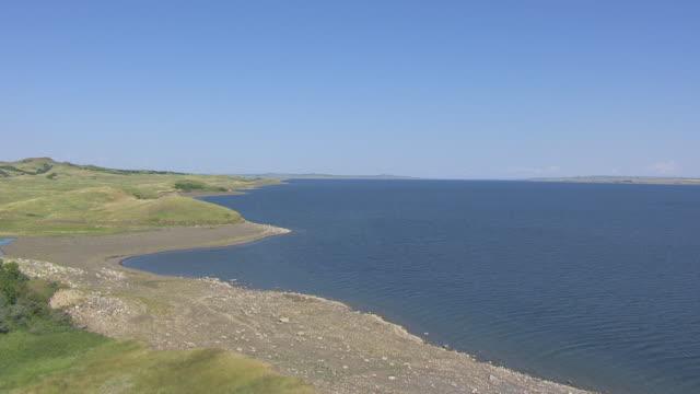 MS AERIAL TU View of green hill to reveal Missouri River / Kenel, South Dakota, United States