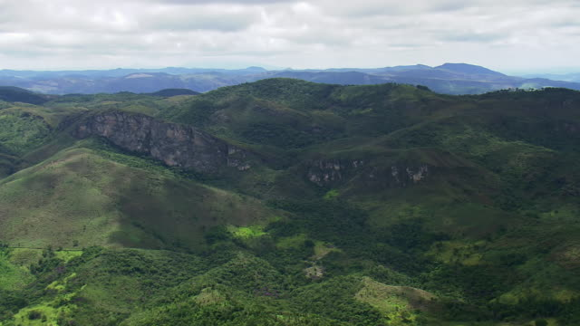 ws aerial view of green mountains / minas gerais, brazil - minas stock videos and b-roll footage