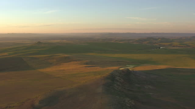 ws aerial view of green river beds with hills in back side with morning sunshine in campbell county / wyoming, united states - plain stock videos & royalty-free footage