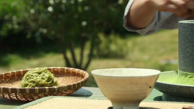 view of green tea being ground with millstone in boseonggun jeollanam-do south korea - millstone stock videos & royalty-free footage