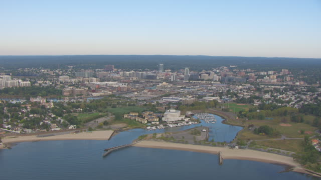 Ws Aerial Pov View Of Greenaway Island And Westcott Cove With Cityscape In Distance Stamford