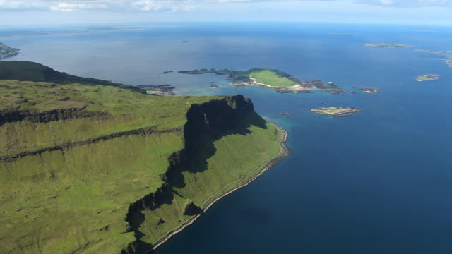 WS AERIAL View of Gribben cliffs and island of Inch Kenneth on west coast / Isle or island of Mull, Argyll and Bute, Scotland