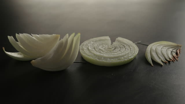 view of grilling the sliced onions - zwiebel stock-videos und b-roll-filmmaterial