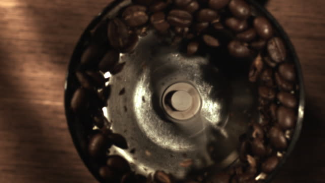 ms slo mo view of grinding coffee / los angeles, ca, united states - macinare video stock e b–roll