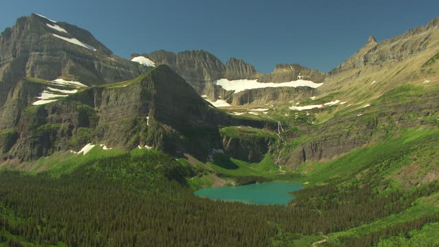 WS AERIAL View of Grinnell Glacier and Grinnell Lake in Glacier National Park / Montana, United States