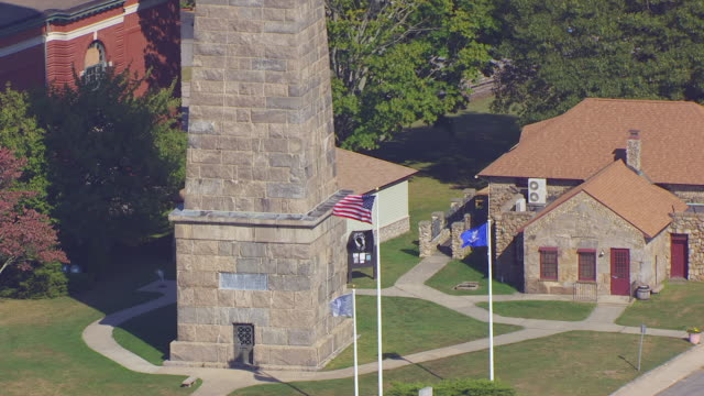 ws zo aerial pov view of groton monument with flags/ groton, connecticut, united states - groton connecticut stock videos & royalty-free footage