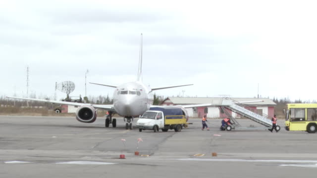 WS View of Ground crew removing stairs from airplane in preparation for take off / Archangelsk, Archangelsk Oblast, Russia