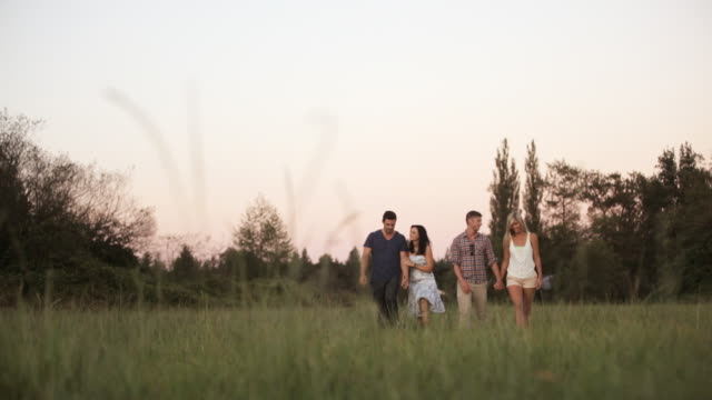 WS View of group of friends walking in countryside / Langley, British Columbia, Canada