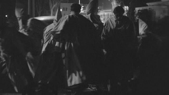 ms view of  group of hooded clansmen get in car and go to away - ku klux klan stock videos and b-roll footage