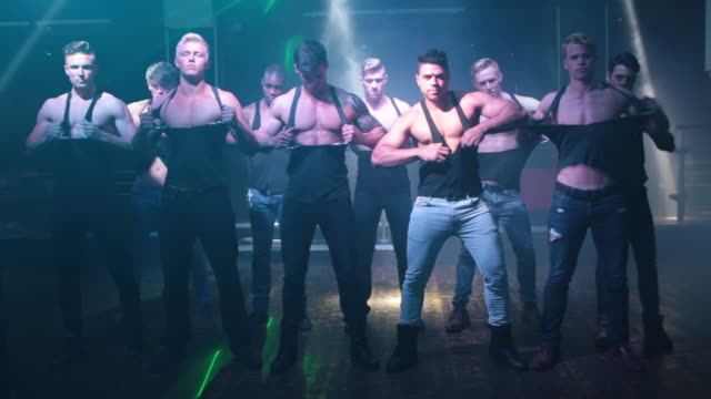 ws view of group of male strippers / london, united kingdom - halvbild bildbanksvideor och videomaterial från bakom kulisserna