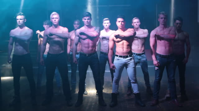 ws view of group of male strippers / london, united kingdom - strip stock-videos und b-roll-filmmaterial
