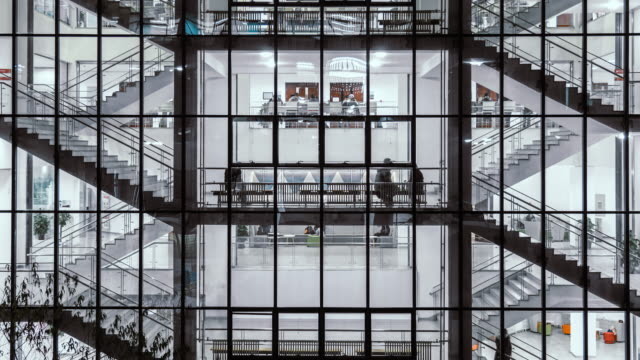 t/l tu view of group of people walking on stairs at night - office video stock e b–roll