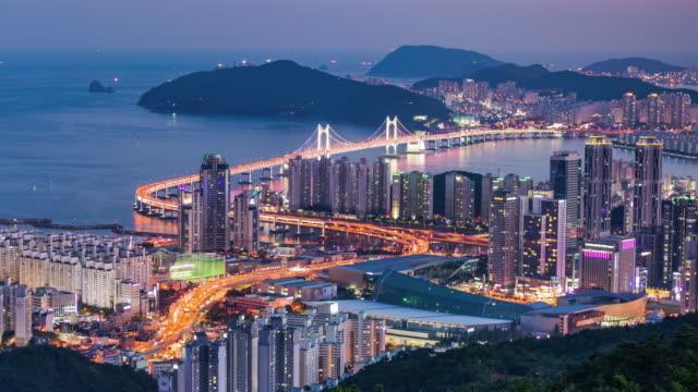 view of gwangandaegyo bridge and busan city at night - busan stock videos & royalty-free footage