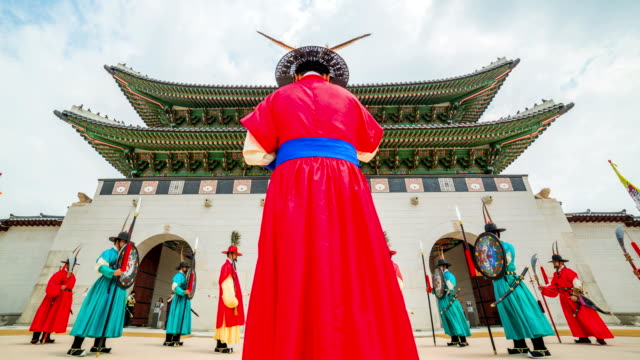 view of gyeongbokgung palace (royal palace of the joseon dynasty, national treasure) royal guard-changing ceremony in front of gwanghwamun gate (popular tourist destinations) - ceremony stock videos and b-roll footage