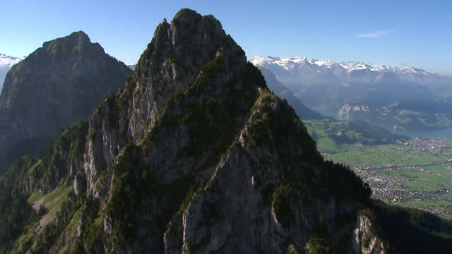 WS AERIAL View of Haggenspitz and Kleiner Mythen, Grosser Mythen in background / Mythen, Schwyz, Switzerland