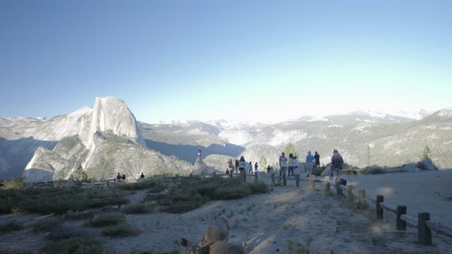 view of half dome and visitors at glacier point at sunset, yosemite national park, unesco world heritage site, california, usa, north america - yosemite national park点の映像素材/bロール