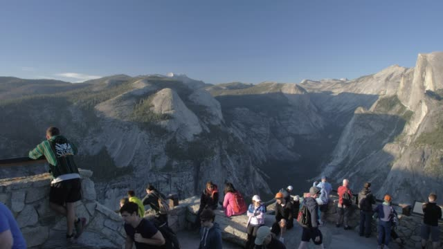 view of half dome and visitors at glacier point at sunset, yosemite national park, unesco world heritage site, california, usa, north america - yosemite national park stock videos & royalty-free footage