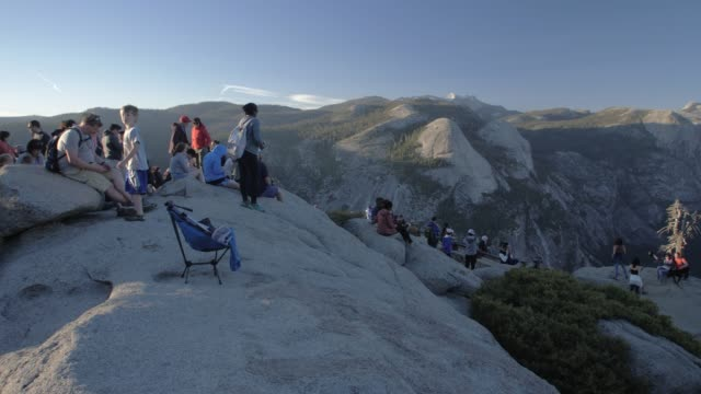 view of half dome and visitors at glacier point at sunset, yosemite national park, unesco world heritage site, california, usa, north america - half dome stock videos & royalty-free footage