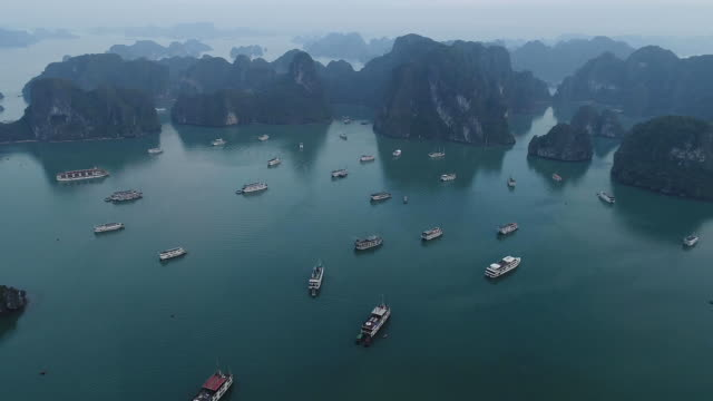 view of halong bay (unesco world heritage site) with the tourboats - halong bay stock videos and b-roll footage