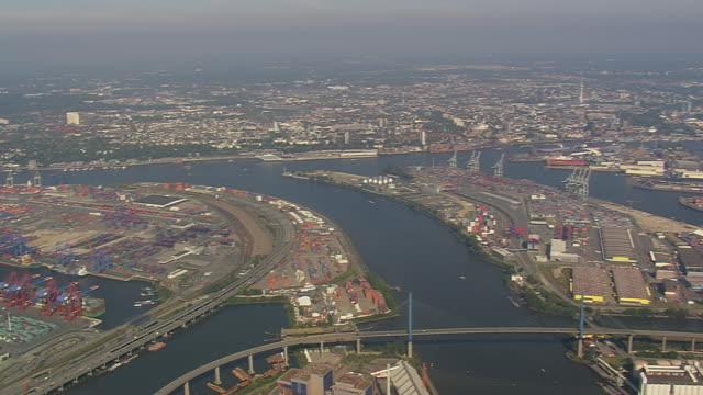 ws aerial view of hamburg port with kohlbrand bridge / germany - porto marittimo video stock e b–roll