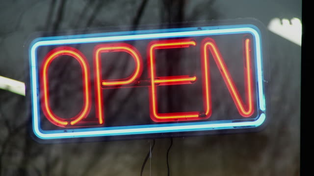 cu view of hand turns off open sign in window / morris, illinois, usa - neon stock videos & royalty-free footage