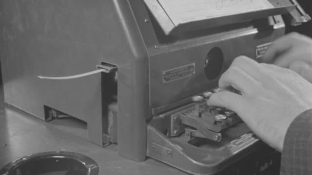 ms view of hands typing on telegraph office machine - telegraph machine stock videos & royalty-free footage