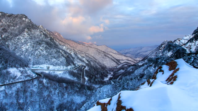 view of hangyeryeong national road in mt.seoraksan national park with snow - mountain road stock videos & royalty-free footage