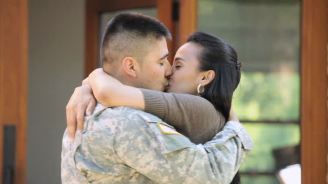 MS View of happily  welcoming soldier with lots of love / Richmond, Richmond, United States