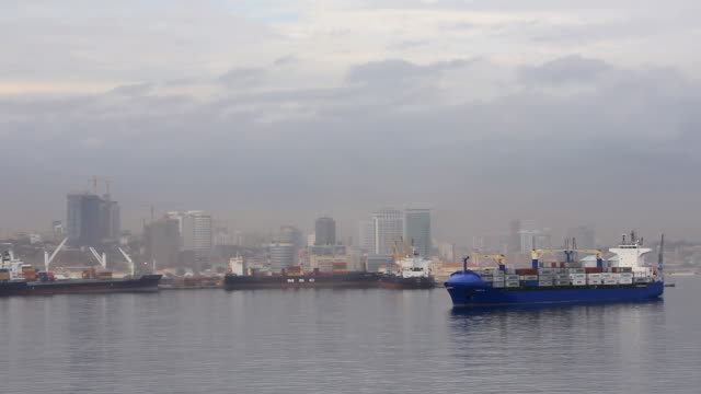 WS View of harbor and ship in sea with city skyline / Luanda, Angola