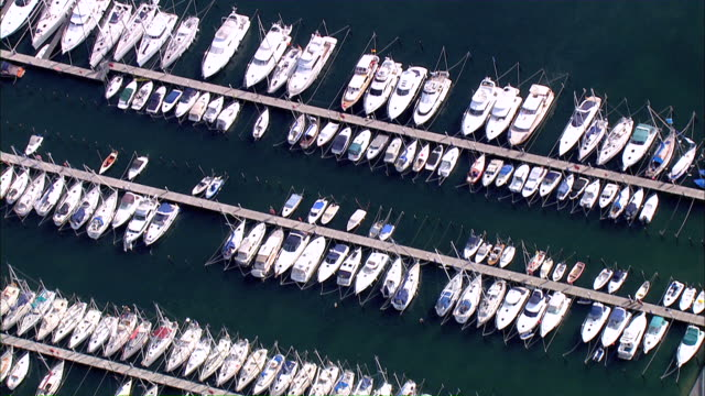 ws aerial pan  view of harbor   / grube, schleswig-holstein, germany - schleswig holstein stock videos & royalty-free footage