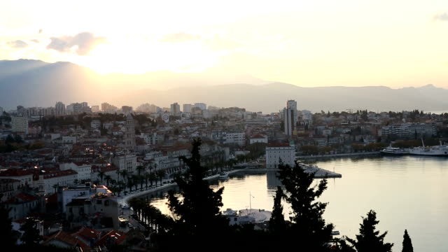 View of harbour, boats and mountains at sunrise, Split