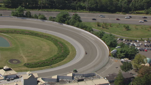 WS AERIAL ZO View of harness racer running Freehold Raceway to surrounding area and highway / Freehold Borough, New Jersey, United States