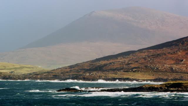 ws pan view of harris island shore / harris island, scotland, united kingdom - isole ebridi video stock e b–roll