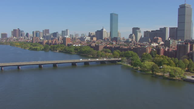 ws aerial pov view of harvard bridge over charles river, background in downtown city with back bay / boston, massachusetts, united states - back bay boston stock videos & royalty-free footage