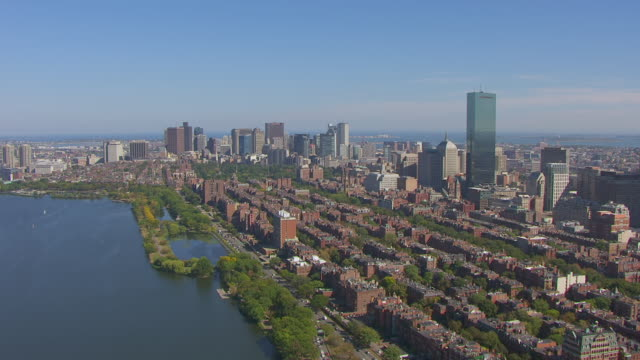 ws aerial pov view of harvard bridge over charles river, background in downtown city with back bay / boston, massachusetts, united states - back bay stock-videos und b-roll-filmmaterial