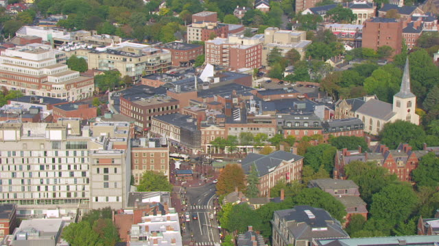 WS ZO AERIAL POV View of Harvard Square and Massachusetts Hall with cityscape / Cambridge, Massachusetts, United States